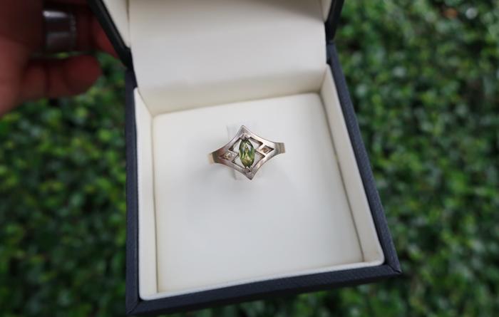 Custom designed engagement ring with Peridot