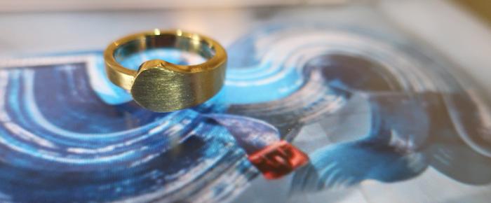 Custom designed engagement ring on painted brush strokes