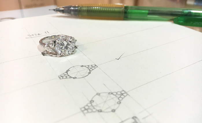 Large diamond ring on sketch of new design