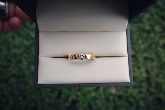 Golden ring with diamond in Half-bezel setting
