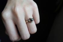 Custom designed engagement ring worn on finger
